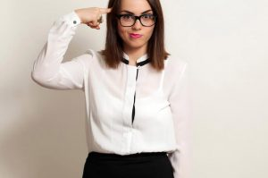Business-Woman-Pointing-At-Brain-Smart